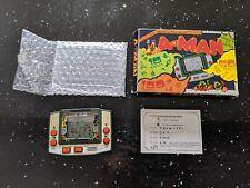 Un Homme (pacman) Vintage LCD handeld Game/Horloge COFFRET-Superbe état