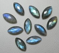 147.88 carats total      051-11-010 flash larger sizes Two Labradorite marquise cabochons