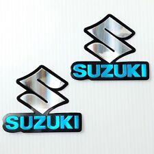 SUZUKI , TANK  EMBLEMS  BLUE  & SILVER FOIL DECALS .