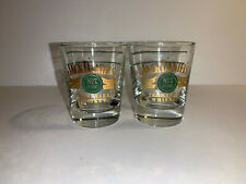 2 JACK DANIEL'S OLD No. 7 SHOT GLASSES GREEN AND GOLD W/ 2 GREEN STRIPES ON BACK