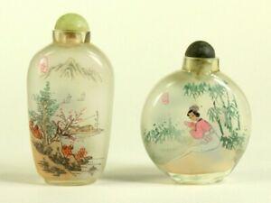 ^ Two Chinese Frosted Blown Clear Glass Reverse Painted Snuff Bottles
