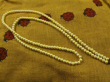"""Shiny White Plastic Faux Pearl Necklace - 47"""" long"""