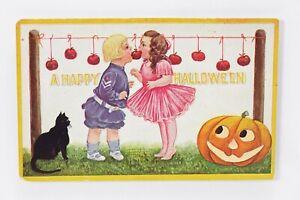 Halloween VTG Postcard International Art Boy & Girl Bitting Apples Cat J.O.L.