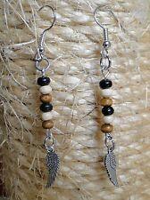 Boucle d'oreille aile d'ange argent et perles de bois. Bijou fait main