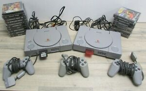 2x PlayStation PS1 SCPH-1002 Audiophile Consoles + 18x Games 4x Controllers