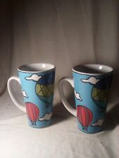 2 Hot air baloon coffe mugs by Ursula Dodge