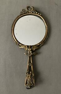 Miroir face à main de style Empire en bronze Aigle bacchante