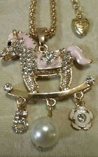 betsey johnson Pink crystal Rocking Horse w/ trinkets necklace