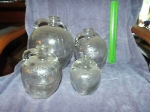 SET OF 4 EARLY GRADUATED SIZES WHITE HOUSE VINEGAR JUGS NO RESERVE