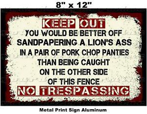 KEEP OUT NO TRESPASSING GO AWAY sign PORK CHOP PANTIES SANDPAPERING A LIONS ASS