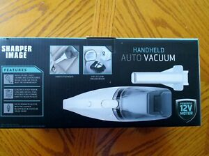 Handheld Auto Vacuum-BAGLESS DESIGN 12V POWER SHARPER IMAGE NEW In Original box
