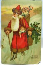 1910 POSTCARD MERRY CHRISTMAS SANTA CLAUS IN LONG COAT,BROWN FUR WITH DOLLS