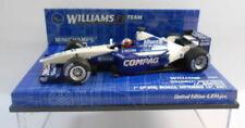 Voitures Formule 1 miniatures blancs sur juan pablo montoya