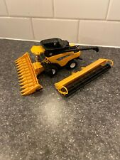 New Holland CR9080 Combine 2009 Farm Show 35years  By Ertl  1/64th Scale