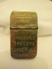 NICKEL PLATED STAMP / MATCH HOLDER  ADVERTISING S.E. SEGERS GROCERS QUINCY, ILL.