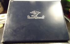 """PREOWNED """"POSTMASTER GENERAL"""" BOOKLET WITH SPACES FOR 9 FIRST DAY ENVELOPES"""