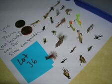 Small fly box with two dozen fly fishing flies midges, nymphs & dry