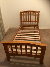 Single wood bed frame with slats in excellent condition