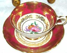 PARAGON RICH GOLD RASPBERRY FLORAL CENTER TEA CUP AND SAUCER