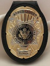 Oval and Star CCW Badge for the Armed Citizen Florida on leather belt clip gold