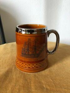 Coffee/tea mug, Susan Clough Designs, H.M.S. Victory, brown / silver