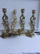 Candelieri mozzafiato in bronzo dorato