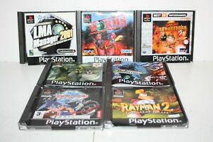 PS1 Game Accessories Bundle - LMA Manager, Worms, Beyblade, Rayman 2 - No Discs