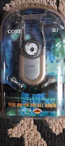 "COBY CX-7 Mini AM/FM Pocket Radio DBBS Earphones Belt Clip Neck Strap ""AAA"""