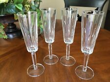 Four (4) Crystal Champagne Flutes Paneled with Vertical Lines Six-Sided Stems
