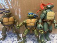 Lot of 3 TMNT action figures Leonardo Donatello Raphael