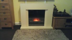 Electric fire With Cream Mantle surround.