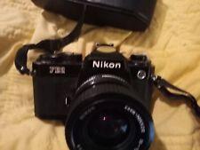 Nikon FE2 35mm SLR Black Camera Body Wlth nikon 35 to 70. Mm lense