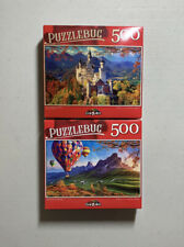 2 New Sealed Puzzlebug Jigsaw Puzzles - 500 Pieces Each. Castle + Ballooning