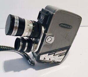 Vintage Yashica-8 movie camera 8mm with dual lenses and Hand Strap