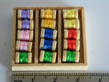 (M21) DOLLS HOUSE BOX OF ASSORTED COLOURS OF COTTON REELS
