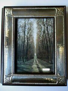 Album fotografico in argento e pelle. 25 x 21cm