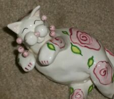 Amy Lacombe reclining playful white cat figure painted pink flowers green leaves