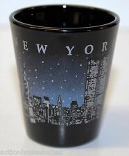 BLACK CERAMIC SHOT GLASS  NEW YORK ( pic of city at night all around it )