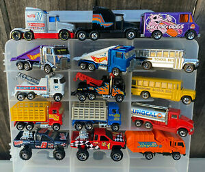 LOT #52 - LOT OF 50 DIFFERENT HOT WHEELS RIGS - BUSES - TRUCKS - BLISTER PULLS