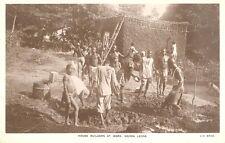 1940s ? RP POSTCARD SIERRA LEONE AFRICA MUD HOUSE BUILDERS AT WORK