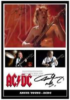 275.  AC/DC  ANGUS YOUNG SIGNED  A4 PHOTOGRAPH