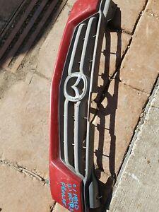 2001 Mazda 121 Metro Grill  metalic red