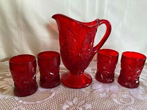Red Pitcher w/4 glasses Mosser USA excellent cond. Marked with M on bottom