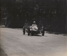REAR VIEW OF SINGLE SEATER RACING CAR PHOTOGRAPH, BY GUY GRIFFITHS.