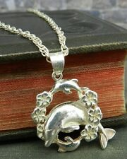Silver Jumping Dolphin in Flower Ring Pendant with Chain