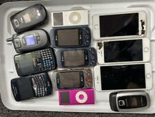 Lot of old cell phones, Blackberry, Apple, Samsung, and ipod