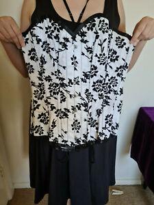 White steel boned corset with black damasque felt embossing