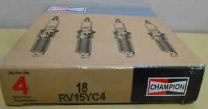 Lot / Box of 4 New Champion 18 RV15YCA Spark Plugs