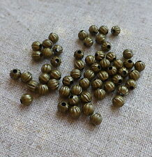 Antique Bronze Brass Corrugated 4mm Beads pack of 200