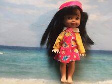 BARBIE'S lLIL SISTER KELLY DOLL W RAINY DAY OUTFIT BLACK HAIR GREEN EYES SO CUTE